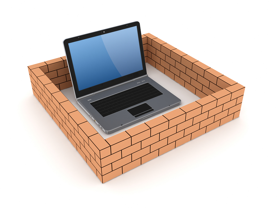 Notebook behind brick wall for safety